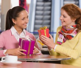 Stock Photo Good friends give gifts to each other