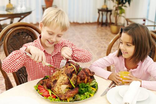 Stock Photo Little boy eating turkey