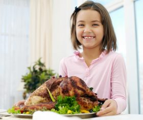 Stock Photo Little girl holding festive sultry turkey