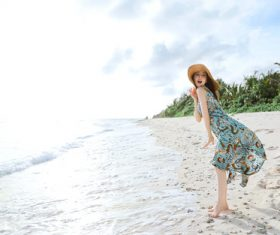 Stock Photo Live waves cute beautiful asian girl seaside posing