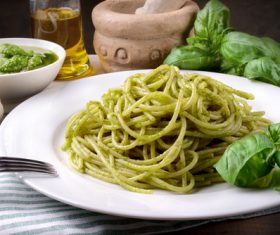 Stock Photo Pine nuts green sauce pasta