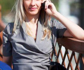 Stock Photo Pretty woman phoning