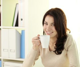 Stock Photo Reading a book drinking coffee smiling girl