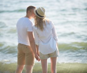 Stock Photo Standing on the beach very intimate Lovers