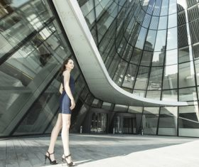 Stock Photo Woman standing in front of the building
