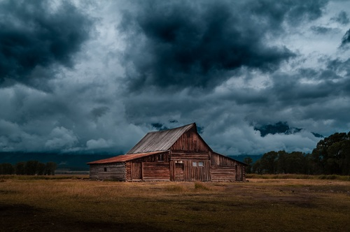 Storm coming and rural barn on the wilderness Stock Photo