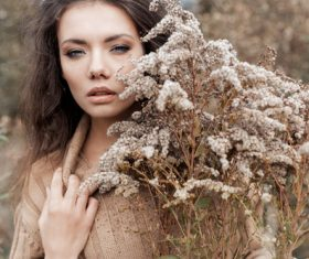 Woman and withered plants Stock Photo