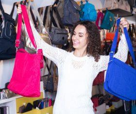 Woman buying bag Stock Photo