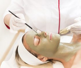 Woman doing skin care in beauty salon Stock Photo 01