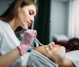 Woman doing skin care in beauty salon Stock Photo 02