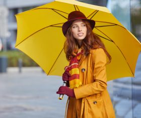 Woman holding up an umbrella on the street Stock Photo