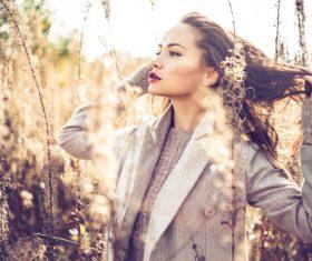 Woman in autumn outdoor pose taking photo Stock Photo