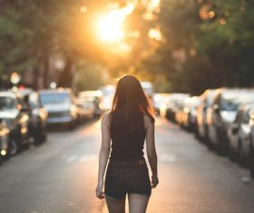 Woman walking in city Stock Photo