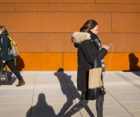 Woman walking looking at mobile phone Stock Photo