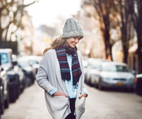 Woman wearing warm clothes on autumn street Stock Photo