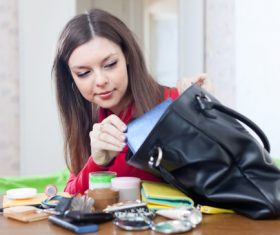 Woman with rummage handbag Stock Photo 02