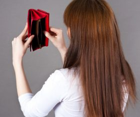 Woman with rummage purse Stock Photo