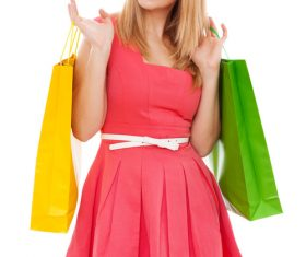 Young beauty holding various color shopping bags Stock Photo 01