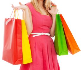 Young beauty holding various color shopping bags Stock Photo 02