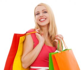 Young beauty holding various color shopping bags Stock Photo 03
