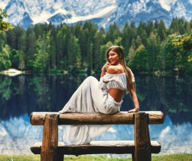 Young happy woman on the lake Stock Photo 01
