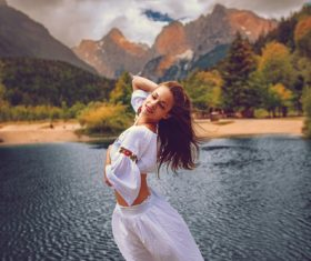 Young happy woman on the lake Stock Photo 06