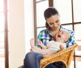 Young mother taking care of baby at home Stock Photo 02