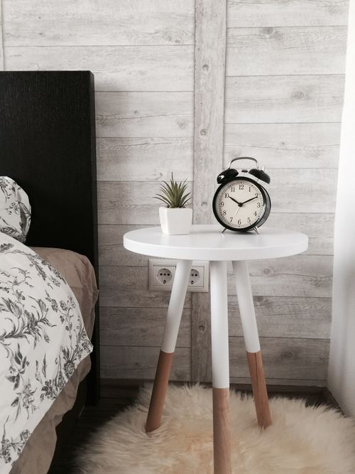 Alarm clock plant placed on the bedside Stock Photo