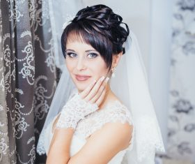 Beautiful charming bride in wedding luxurious dress Stock Photo 16