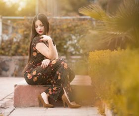 Beautiful female model wearing black floral dress Stock Photo