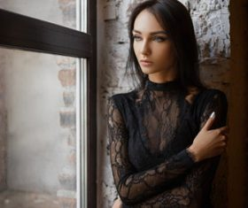 Beautiful girl wearing black lace dress Stock Photo