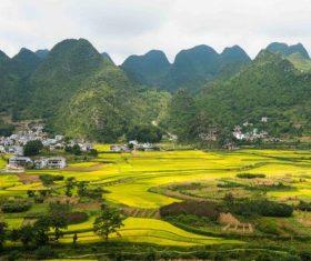 Beautiful mountain village and farmland Stock Photo 01
