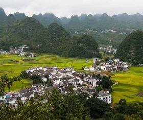 Beautiful mountain village and farmland Stock Photo 02