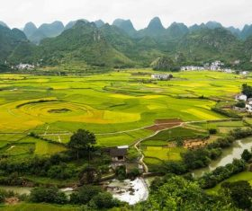Beautiful mountain village and farmland Stock Photo 03