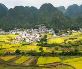 Beautiful mountain village and farmland Stock Photo 04