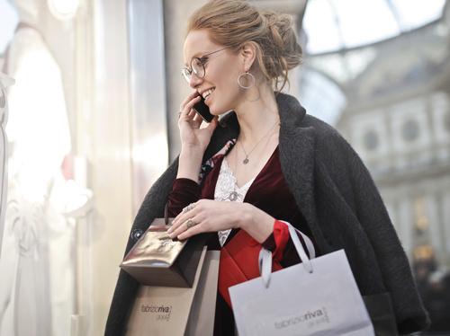 Beautiful woman carrying shopping bags Stock Photo 09
