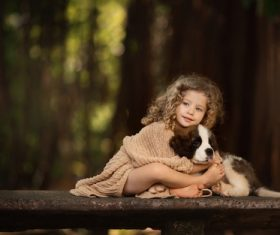 Cute little girl holding puppy Stock Photo
