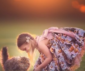 Cute little girl playing with cat Stock Photo
