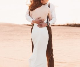 Desert affectionate wedding photos Stock Photo