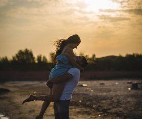 Dusk beach couple Stock Photo