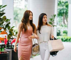 Female girlfriends shopping Stock Photo