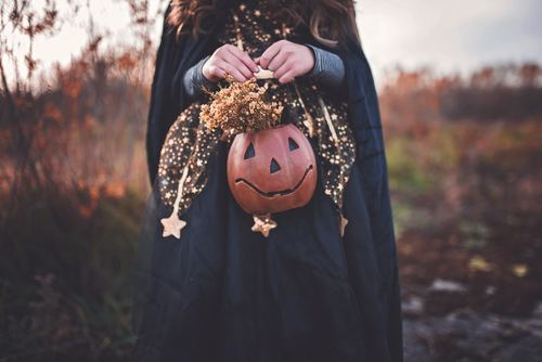 Girl holding pumpkin light Stock Photo