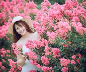 Girl taking pictures with beautiful flowers Stock Photo