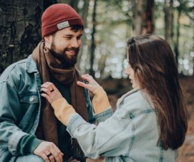 Help boyfriend tidy up scarf Stock Photo