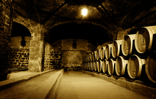 Large capacity wine barrels stored in the basement Stock Photo 02