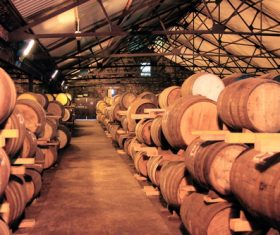 Large capacity wine barrels stored in the basement Stock Photo 05
