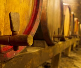 Large capacity wine barrels stored in the basement Stock Photo 06