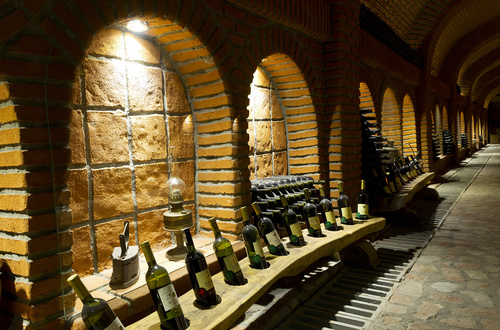 Large capacity wine barrels stored in the basement Stock Photo 09