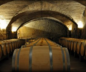 Large capacity wine barrels stored in the basement Stock Photo 10