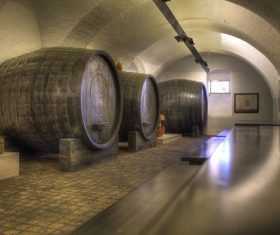 Large capacity wine barrels stored in the basement Stock Photo 11